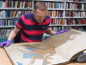 Researcher viewing map in Local Studies & Archive Centre
