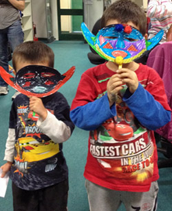 boys showing masks made at Junior History Club