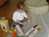 Photograph of a baby with books