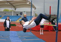 Image of Year 11 pupil Stephen Godwin clearing the bar in the high jump