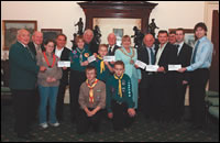 Cllr Oldham, the Mayor and District Assembly Chairs present the scouts with their cheques