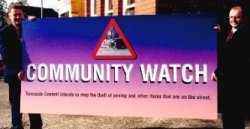 a photograph of the Community Watch sign