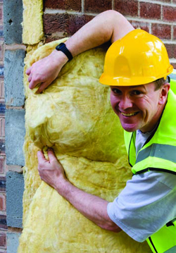 A builder working with insulation
