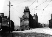 Grapic - Stalybridge Town Hall from Portland Place. Side of building on the left shows large advertisement , circa 1910
