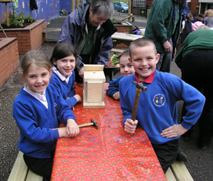 Pupils from Milton St John, Mossley, making bird boxes