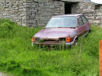 A photograph of an abandoned vehicle
