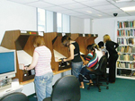 Researchers using microfim readers at Tameside Local Studies and Archives. Most church records are held on microfilm.