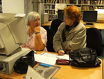Visitors at Tameside Local Studies and Archives using pcs for family history research