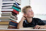 Picture of a boy with a pile of books
