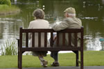 Image of an Elderly Couple sat on a bench