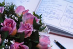 Image of marriage register, flowers and pen