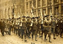 8th Bn marching along London Road, Manchester on their return from Belgium in 1919.  Captain Stewart in front. (MRP4/E)