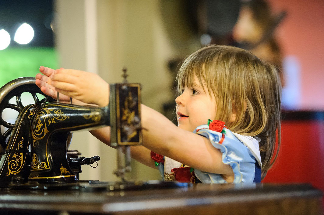 Photo of a Girl with a sewing machine at Portland Basin Museum