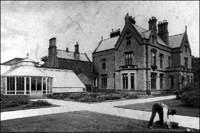 Old Photograph showing someone attending the gardens outside Ryecroft Hall