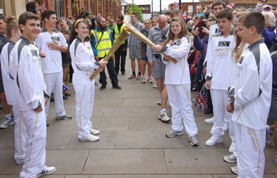 Torch bearers completing the 'kiss'