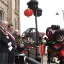 Image of the Dragon greeting Tameside Mayor Cllr John Sullivan