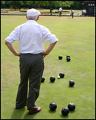 Picture of man playing bowling on a bowling green
