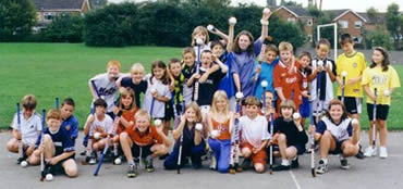 Group photograph of children who have played hockey