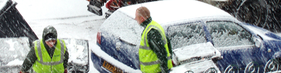 Refuse collection men working in snowy conditions